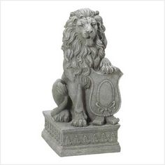 "Statue | Lion Guardian  With his mighty paw placed atop a crested shield, a regal lion surveys all who approach the door to your ""castle"".  #38624   $65.00 Free Shipping"