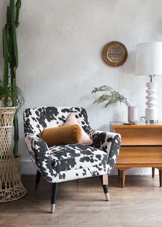This chic mid-century faux cow hide lounge chair is fun, bold and stylish. Available in Brooklyn, NY, it also comes with a matching loveseat.
