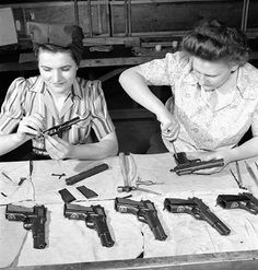 Final assembly of High Power pistols for issuance to Allied forces under a Canadian Mutual Aid Board contract at the Inglis factory (Toronto, ca. 1944)