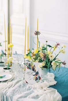 Such a unique and beautiful centerpiece idea. Beautiful tones of teal and yellow.