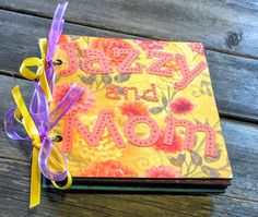 This is a mini scrapbook album that was customized for a mother and daughter! There are 12 pages total, including the front page and back cover with 11 places for you to add your cropped photos. The perfect brag book you can keep in your purse and pull out to show off your favorite pictures!  You can give this as a gift or keep it for yourself and fill with your favorite photos of you and your daughter.  This is a 6x6 chip board album, decorated with fun scrapbook paper and embellishments…