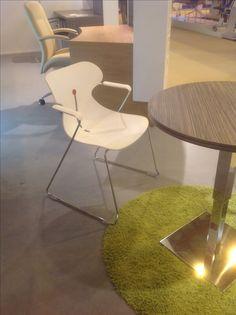 Desiro DOT white polypropylene high volume stacking chair by Koehl Seating