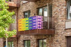 "Design platform Studio Curiosity worked with local residents in east London to wrap a bridge and balconies in a rainbow of ribbons as a ""message of hope"" during the coronavirus pandemic."