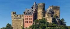 Schönburg Castle, one of the most romantic and beautiful castle hotels in Germany, along the Rhine River in Oberwesel, Germany. | Stayed here during a tour of Europe. We loved our room (#18) with a view of the Rhine River and a door that opened onto the castle wall. The restaurant serves delicious food. We also really enjoyed our Rhine river cruise. I would totally go back.