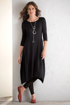 Kati Dress by Comfy USA. Sometimes, it's the simplest details that make a piece indispensable—like the flattering bodice shaping and distinctive scooped hem of this artful LBD. Overview: Three-quarter sleeves Below knee length Artist-made in the U.S.A. Fabric & Care: 92% modal/8% elastane Hand wash cold, dry flat Fit & Sizing: Relaxed fit: a looser drape on the body, cut for full comfort and ease Regular sizes XS (0–2), S (4–6), M (8–10), L (12–14), XL (16) Plus sizes 1X (14W–16W), 2X…