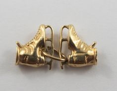 A personal favorite from my Etsy shop https://www.etsy.com/ca/listing/249529019/pair-of-skates-14k-gold-vintage-charm