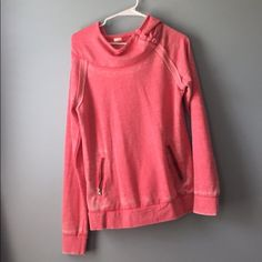 Roxy sweatshirt Pink Roxy wear shirt, with buttons in the front, hoodie and design in the back, 2 pockets for you hands, and never worn Roxy Tops Sweatshirts & Hoodies