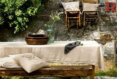 Use a painters drop cloth outdoors, or indoors with lovely china as a textural contrast.
