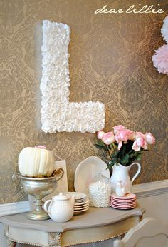 Love the initial! It was done by cardboard and then a lot of cupcake liners! So girly and gorgeous!