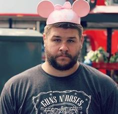 Kevin Owens in a Guns N Roses shirt while wearing  Pink Mickey Mouse ears...your argument is invalid