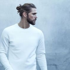 This guy is going over the ne for his Hairbun beard combination on his White Crewneck