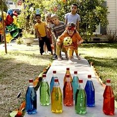 Lawn Bowling: Make your own pins by filling some recycled plastic bottles with water and food coloring.
