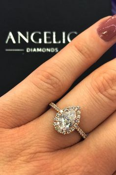 Shine bright like a diamond with this pear diamond engagement ring. Featuring a large pear-shaped diamond surrounded by a diamond halo, this could be anyone's dream engagement ring.