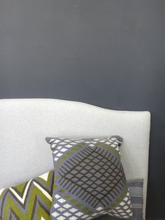 Our client asked us to create a custom headboard for her. She chose the curved style and the heather grey flannel-like fabric. A welt of the same fabric created a finished edge.