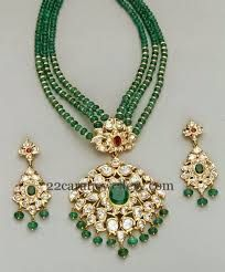 Three layered small round emeralds beads set with gold bits. Two step pachi work kundan pendant. Studded with large ruby, emerald stones. Indian Wedding Jewelry, Bridal Jewelry, Beaded Jewelry, Beaded Necklace, Necklaces, Bead Jewellery, Jewellery Shops, Pearl Necklace, Indian Jewellery Design