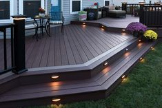 AZEK decking with post cap and and riser lights. A beautiful way to keep your backyard lit at night. AZEK decking with post cap and and riser lights. A beautiful way to keep your backyard lit at night. Backyard Lighting, Deck Lighting, Lighting Ideas, Landscape Lighting, Accent Lighting, Exterior Lighting, Lighting Design, Backyard Patio Designs, Backyard Landscaping