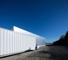 Polycarbonate Dock Building glows on Vancouver beachfront