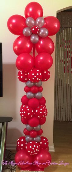 Red polka dot balloon column with flower on top! Great for #MothersDay or spring decoration