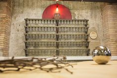 Interactive rack hand-made with reclaimed wood and recycled glass jar for La Colaboradora co-working  by Pétula Plas