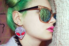 Earring. Glasses. Hair. Lips. Collar.
