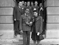 Wartime weddings, such as this English couple's town hall ceremony, often saw the groom wearing his military uniform, while the bride donned her best dress in lieu of a gown.
