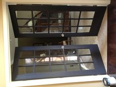 Black French Doors would make a statement... From Kitchen/Dinning room into Living room!