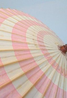 Soft pink and white beach umbrella.