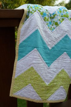 If I could quilt, this would be it with brighter colors....Grandmother are you seeing this! Would love! HA!  I am hoping my grandmother repins this!  Chevron quilt!