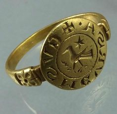 "Fourteenth century Byzantine gold ring. The edge of the bezel is engraved with ""mirror writing"" with typical letters used in the fourteenth century , the middle is with a armorial bird and star. Diameter of bezel : 13 mm"
