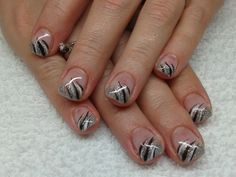 silver tips with black, white and silver striping nails