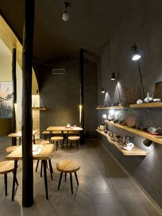 Czech studio A1 Architects covered the walls of this cafe  in Prague with a tactile mixture of black plaster, coal and pieces of straw, in a modern take on the clay plasters used inside traditional Japanese tea houses