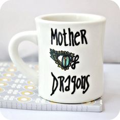 Gift ideas for Game of Thrones fans: A mother of dragons mug.