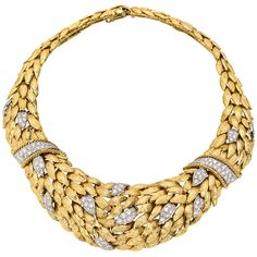 "Foliate-style link collar necklace, designed with textured gold flexible links, accented by pavé diamond sections in platinum, the necklace mounted in 18k yellow gold, signed ""Webb"" for David Webb. 48k USD"