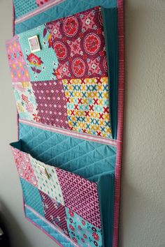 this one is great for sorting our mail. Don't like the combination of teal and pink. Would be great in green/brown