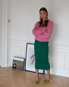 Knitwear gets a new season update from Victoria Beckham with bubble-gum pink hues and chic cinched…""