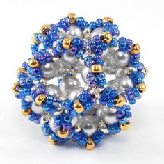 A Mini Ionic Dodecahedron, based on Gwen Fisher's new Ionic Polyhedra pattern at www.beadinfinitum.com. Swarovski crystal pearls and Japanese seed beads. Created November 2010.
