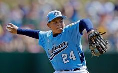 San Lorenzo, Puerto Rico's Tommylee Sierra pitches during the first inning of a game against Perth, Australia in International elimination play at the Little League World Series in South Williamsport, Pa. Saturday. (Matt Slocum/AP)
