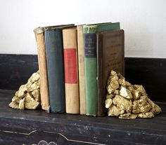 DIY Alchemy Stones Bookends. Once you've glued and painted the rocks, add some leafing for extra flair.