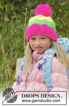 """New free pattern! Knitted DROPS hat with pompom and zig zag pattern in """"Peak"""". Share your projects with us using #DROPSBeanie!"""