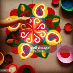 View top-quality stock photos of A Hand Finishing A Rangoli. Find premium, high-resolution stock photography at Getty Images. Rangoli Designs Flower, Rangoli Patterns, Colorful Rangoli Designs, Rangoli Ideas, Rangoli Designs Images, Rangoli Designs Diwali, Diwali Rangoli, Flower Rangoli, Beautiful Rangoli Designs