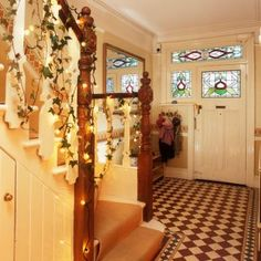 Christmas hallway decorating ideas to impress your guests. These hallway solutions will make you feel festive the moment you step through the front door