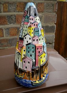 Italian Retro Pottery Lamp 1950′s  The internal globe emits light from all the windows.  ( beetle2001cybergreen - Flickr )