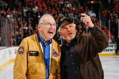 Former NASA astronaut and commander of the Apollo 13 mission, Captain James A. Lovell, talks with Vietnam veteran Captain Charles Pyne before the game. #Blackhawks