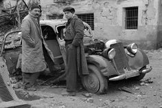 Journalist Ernest Hemingway (1899-1961) and filmmaker Joris Ivens (1898-1989), posing in front of a damaged Mercedes during the Spanish Civil War 1937. photo: John Fernhout (1913-1987), found on http://spanje-kunst.blogspot.nl/