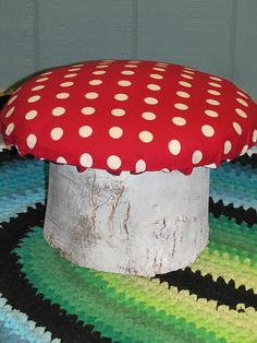 Toadstool stools! Each stool is composed of a sawed log, one-inch plywood, woodscrews, non-toxic water-based paint, 3-inch foam and organic cotton material.