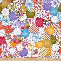 Loralie Designs Lazy Beach Umbrellas Multi from @fabricdotcom  Designed by Loralie Harris for Loralie Designs, this cotton print fabric shows umbrellas from above with bright colors and fun prints that are far from your standard black umbrella. Perfect for quilting, apparel and home decor accents. Colors include white, black, purple, lavender, golden orange, yellow, orange, army green, tan, blue and shades of pink.