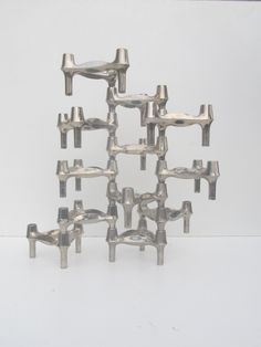 Set of 12 space age candle holders designed by Fritz Nagel BMF 1960s candle sticks & stackable. €168.00, via Etsy.