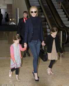 Homecoming: Australian actress Nicole Kidman was spotted arriving at Sydney Airport with her daughters Sunday Rose, seven, (R) and Faith Margaret, four, (L) on Thursday - as she returns Down Under to celebrate the Easter holiday with her family