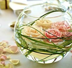 Centerpiece - flower arrangement suggestion - created with flowers, vines and a glass vases.