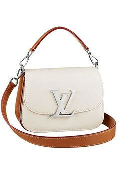 Louis Vuitton, I'm not usually a fan of light colored handbags, but I love this!